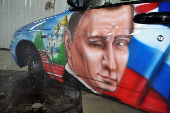 подмигивающий Путин